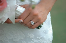 Bride wears huge engagement ring with three diamonds