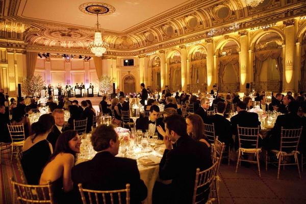Black tie wedding guests dine at Donatella Arpaia's wedding