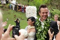 Angus Mitchell, co-owner of John Mitchell Systems, and his bride after Hawaiian wedding ceremony