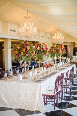 colorful long tablescape tall centerpieces yellow salmon pink orange candelabra wedding la valencia