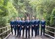 wedding portrait of groom with groomsmen all in blue suits and neckties on wood bridge santa barbara