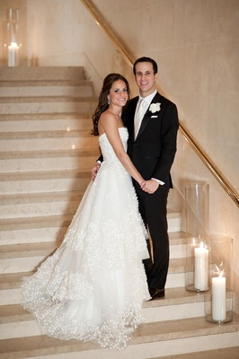 Monique Lhuillier wedding dress with tiered skirt and groom