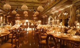 wedding reception the mar-a-lago club opulent luxury ballroom chandelier serpentine table oval back