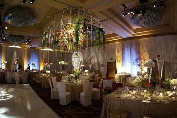 Ballroom reception space with towering centerpiece