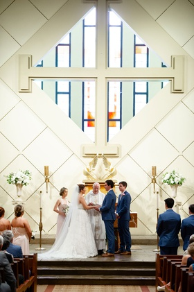 bride and groom at altar catholic church classic traditional wedding ceremony personal vows