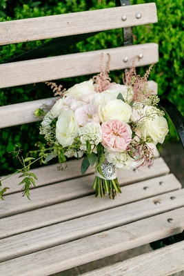 bridal bouquet with blush and ivory garden roses, astilbe, crystal brooch