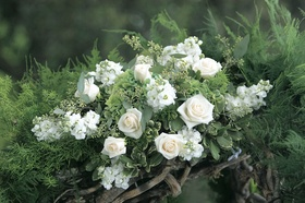 Close up photo of white flower chuppah decorations