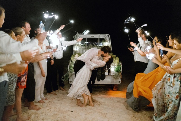 bride in lace second dress for grand exit beach truck sparkler exit on beach destination wedding