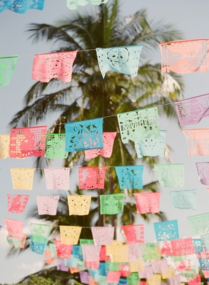 Wedding welcome party destination wedding rehearsal dinner Mexico flags cutouts paper