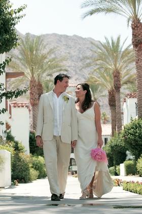 Mary Dann and groom walking through resort