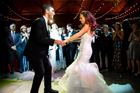 wedding in barn twinkle lights bride in trumpet bridal gown wedding dress first dance with guests