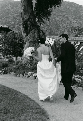 Black and white photo of couple walking
