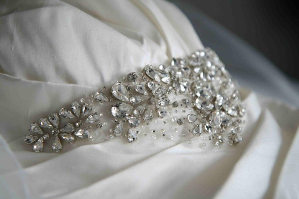Enuka Okuma's crystal sash on her wedding dress