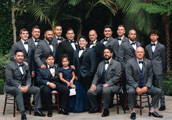 same-sex wedding inspiration, gay wedding with groomsmen in grey suits, flower girl in navy