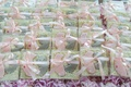 Wedding favor cookies with pink California and grey New Jersey tied with pink ribbon