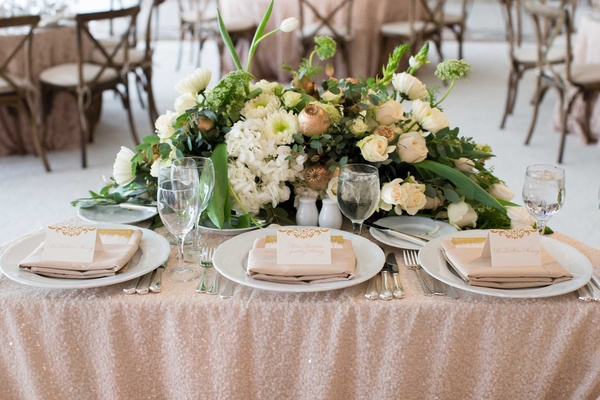 DeMarco Murray wedding with three person sweetheart table for couple and daughter