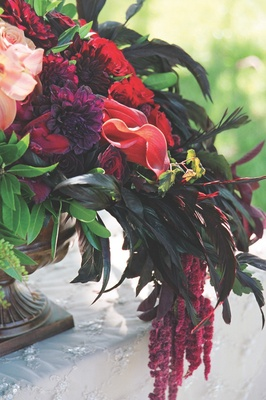 Purple and red flowers in antique vessel