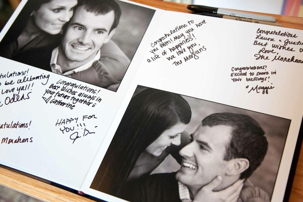 Guestbook with black and white photos of couple