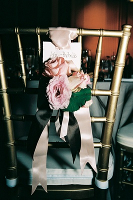 Gold chair with ribbon and flower decoration