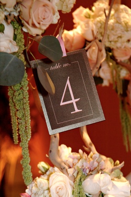 Table number display on manzanita centerpiece