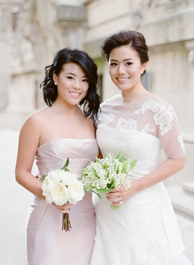 Bride in Vera Wang wedding dress lily of the valley bouquet and maid of honor bridesmaid with roses