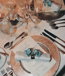 Gold charger plate with white napkins