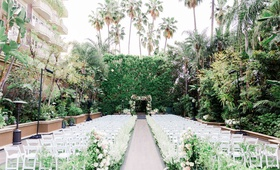 wedding ceremony at the four seasons hotel los angeles at beverly hills greenery white chairs