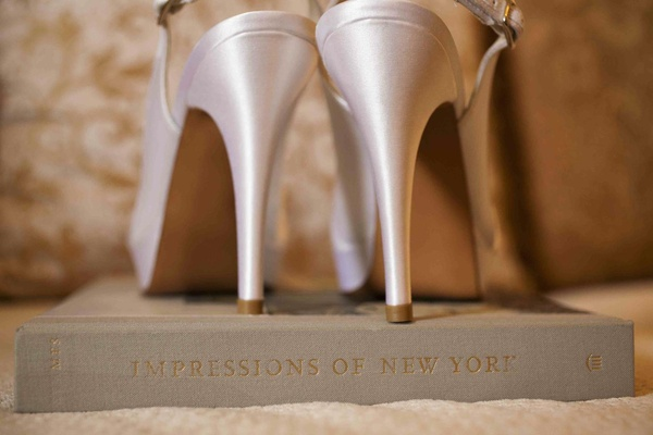 Wedding shoes on top of Impressions of New York book