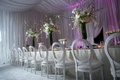 Kandi Burruss's white reception table with purple lighting