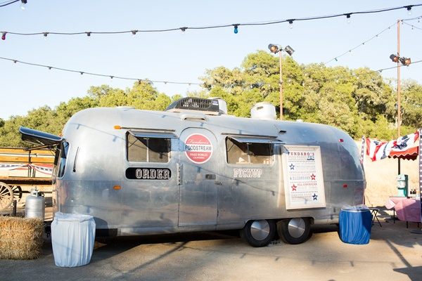 Food truck in airstream trailer serving fourth of july bbq food