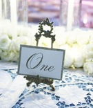 Romantic gold place cards on antique stands