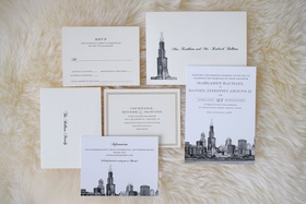 white and ivory invitation suite with illustration of chicago skyline