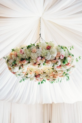Lush flower chandelier with pink, apricot, white hydrangeas and roses flower chandelier tent wedding