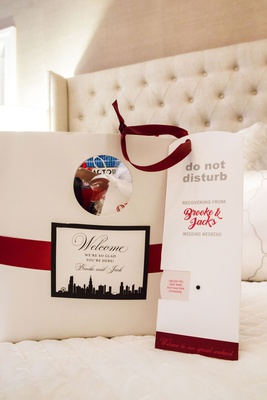 wedding welcome bag chicago skyline red ribbon do not disturb sign recovering from wedding weekend