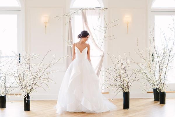 Bride in hayley paige wedding dress layered skirt, plunging neckline, spaghetti straps