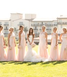 Bride and flower girl with asymmetrical bridesmaid dresses