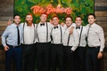 wedding reception moss photo booth backdrop neon sign groom groomsmen in suspenders bow ties