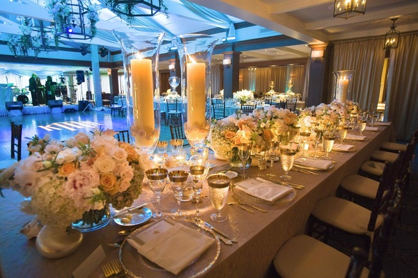 Neutral wedding tablescape with blue lighting on dance floor