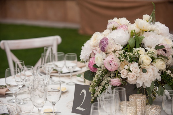 Black and white table number low centerpiece with pink lavender flowers white peony and rose greens