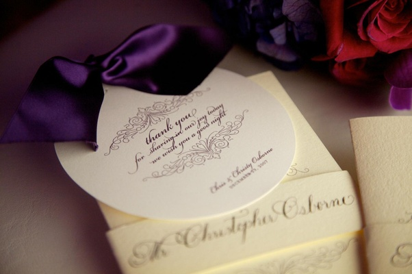 White circle stationery with purple script and ribbon