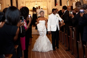 Guests take photos of Jarett Dillard and bride at wedding