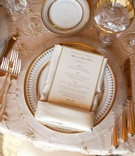 Beaded linens topped with gold-rimmed plates