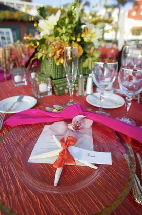 pink tablecloth with green centerpiece and starfish details