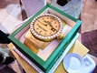 Wedding groom's cake surprise gold rolex with diamonds in green box at Tracy Morgan wedding