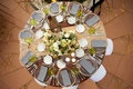 Wood reception table with striped napkins and green glasses