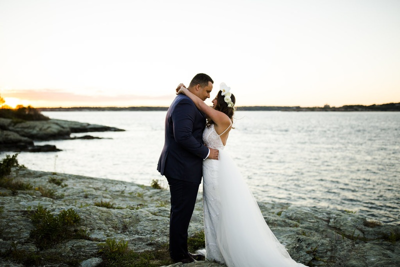 groom navy suit bride dress flower crown newport rhode island ocean shoreline berta bridal desinger