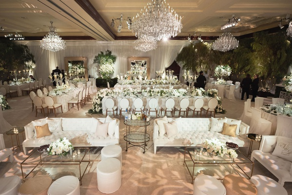 wedding reception ballroom white decor flowers chandeliers fresh greenery trees