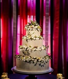 Antique white cake with sugar flowers and fruit