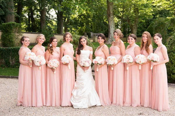 Bride in Pnina Tornai wedding dress with bridesmaids in long blush bridesmaid dresses bouquets