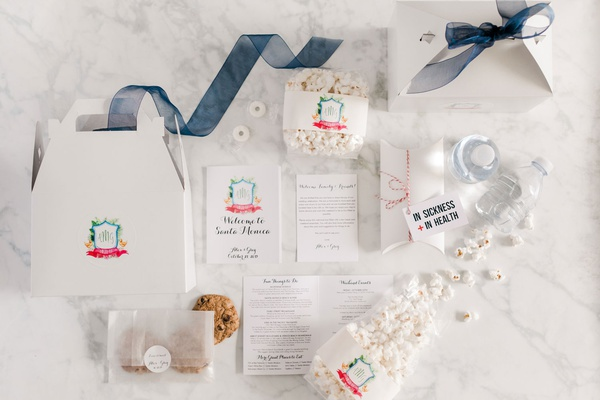 wedding welcome box with santa monica itinerary cookies popcorn water bottle emergency kit ribbon